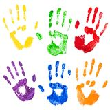 Vector isolated multicolored paint hand prints. Vector isolated on the white background yellow,green,red,violet,blue,orange paint hand prints Royalty Free Stock Photos