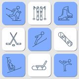 Nine Icons - winter sport activities. Vector isolated nine thin line icons of winter sport activities on blue background. Skate, ski, snowboard, hockey and Royalty Free Stock Photography