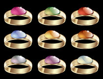 Vector jewelry rings. Vector set jewelry rings with bright iridescent gemstones set in gold minerals. Bright colored precious elements on a black background Stock Photos