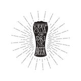 Vector keep calm and drink beer - quote inside the glass of beer. Monochrome vintage beer quote. Isolated on white. Royalty Free Stock Image