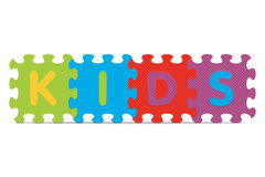 Vector KIDS written with alphabet puzzle Stock Photos