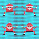 Vector knitted Santa Claus in crab pose Stock Photo
