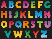 Vector l'alfabeto dai residui lacerati di carta colorata Fotografia Stock