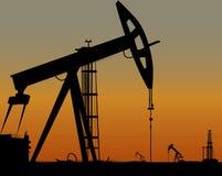 Vector l'immagine delle torri di olio sulla terra Immagini Stock Libere da Diritti