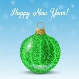 Vector la bola verde del Año Nuevo en fondo de los copos de nieve Foto de archivo