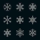 Vector la raccolta dei fiocchi di neve, icona bianca su un fondo nero illustrazione di stock