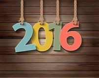 Vector la tarjeta de felicitación de papel del Año Nuevo 2016 en la textura de madera stock de ilustración