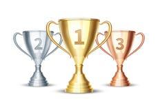 Vector la taza del oro, del plata y de bronce del ganador Foto de archivo libre de regalías