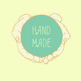Vector label HAND MADE with cupped hands Royalty Free Stock Image