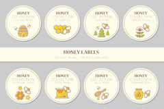Vector label template design - natural honey collection. Vector label or sticker template with honey emblems. Natural honey tags collection (sorts of honey Stock Photo
