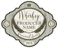 Label for whiskey with ears of barley. Vector label for whiskey in the figured frame with crown, ears of barley and handwritten inscription on striped background Royalty Free Stock Photo