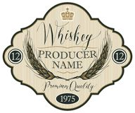 Label for whiskey with ears of barley. Vector label for whiskey in the figured frame with crown, ears of barley and handwritten inscription on striped background Stock Photos