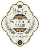 Label for whiskey with ears of barley and barrel. Vector label for whiskey in the figured frame with crown, ears of barley, wooden barrel and handwritten Royalty Free Stock Photography