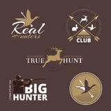 Vector labels with duck, deer, hare, gun and hunter royalty free illustration