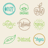 Vector labels in trendy mono line style. Premium quality organic and natural badges for fresh farm products and food packaging - set of linear emblems and Stock Photos