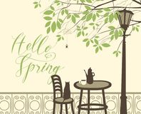 Spring street cafe under tree with cat and spider. Vector landscape with a handwritten lettering Hello Spring. Street cafe with tea or coffee on the table, cat Royalty Free Stock Photography