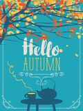 Autumn landscape with cup and kettle on the table Royalty Free Stock Photo