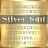 Vector le lettere, le cifre e la punteggiatura rivestite d'argento dell'alfabeto sul fondo dell'oro Fotografia Stock