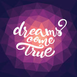 Vector lettering 'Dreams come true'. Vector lettering of inspirational quote 'Dreams come true' on triangle pattern Stock Images