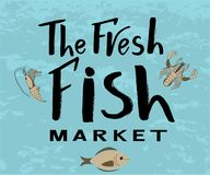 The fresh fish market logo on blue background. Vector lettering of  text The fresh fish market. Modern calligraphy.Template of logotype of fish shop, label, icon Stock Photos
