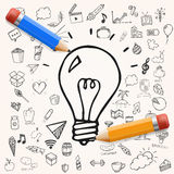 Vector light bulb hand drawn, doodle illustration with yellow and blue pencil for design, set of doodle objects Royalty Free Stock Images