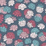 Vector lilies seamless pattern in pink, red and blue pastel colors on navy background. Vintage floral design. Royalty Free Stock Photography