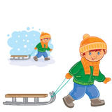 Vector little boy pulling a sledge behind him Royalty Free Stock Photo