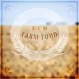 Vector logo for farming. Blurred landscape background with rye Royalty Free Stock Image