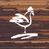 Vector logo. Hand drawn hen Painted brush white cock on farm on wood background Royalty Free Stock Photo