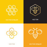 Vector logo and packaging design templates in trendy linear styl. E - natural and farm honey concepts - labels and tags with bees, honeycombs and flowers vector illustration