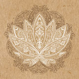 Vector lotus 66. Unusually Vector image of a lotus, ornate paisley mandala and mehendi on kraft paper Royalty Free Stock Images