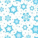 Vector a luz do feriado - mão azul flocos de neve tirados dos christmass Imagem de Stock Royalty Free