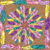 Vector mandala with colored feathers Stock Image