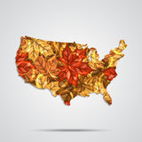Vector map of the USA with a background of autumn maple leaves. Vector Illustration. Royalty Free Stock Photo