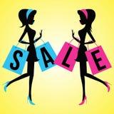 Vector meninas da forma com os sacos de compras com a venda da palavra ilustração royalty free