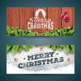 Vector Merry Christmas banner illustration with typography design and pine tree branch on vintage wood background. Royalty Free Stock Photos