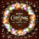 Vector Merry Christmas and Happy New Year 2017. Glowing Christmas wreath made of led lights on the wooden background. Christmas li Royalty Free Stock Photos