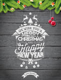 Vector Merry Christmas Holiday and Happy New Year illustration with typographic design and snowflakes on wintage wood background. Royalty Free Stock Photos