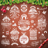 Vector Merry Christmas Holidays and Happy New Year illustration with typographic design set on vintage wood texture background Stock Image