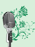 Vector microphone on green floral background Royalty Free Stock Photos
