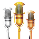Vector Microphones. Vector set of gold, silver and bronze Retro Microphones. No transparency Stock Photos