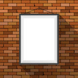 Vector mockup. White poster with black frame hanging on a dark red brick wall. Empty blank. Grunge brickwork background Royalty Free Stock Photo