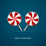 Vector modern christmas candy on blue background Royalty Free Stock Photos