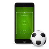 Vector modern smartphone with a soccer ball Royalty Free Stock Image