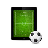 Vector modern tablet with a soccer ball Stock Image