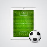 Vector modern white tablet with a soccer ball Royalty Free Stock Image
