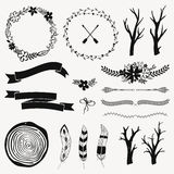 Vector monochrome decoration set with arrows, feathers, floral frames, borders, ribbons, branches. Stock Image