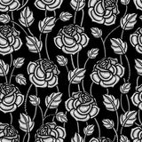 Vector monochrome seamless pattern with embroidery Rose flower and leaves in white on the black background. Royalty Free Stock Photos