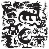 Vector monsters set. Large collection of cartoon monsters vector silhouettes royalty free illustration