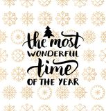 Vector The Most Wonderful Time of the Year lettering design on snowflakes background.Christmas,New Year seamless pattern Stock Photos